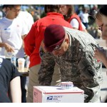 soldier helping with care packages